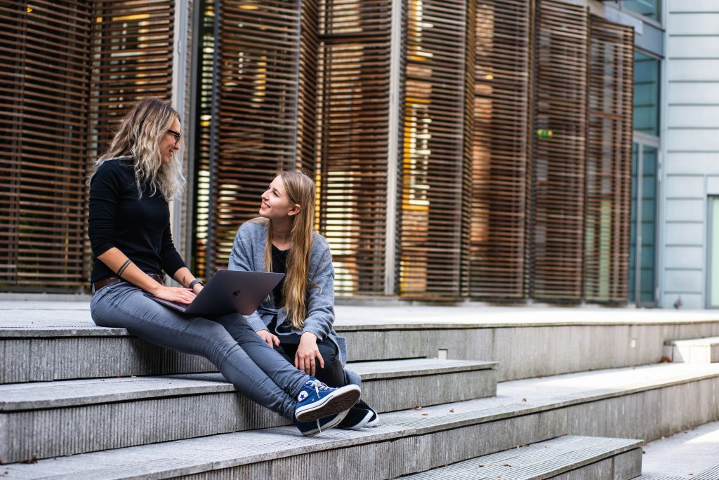 group of two young female students talking outside a university building  6 Top Tips