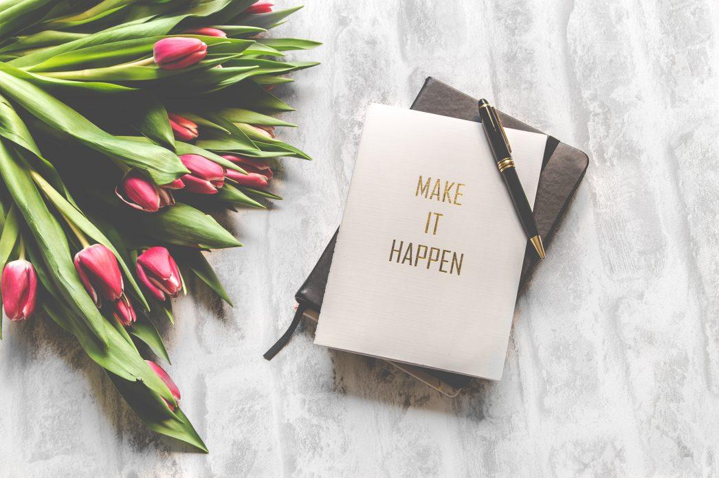 Notebook saying 'Make it happen'